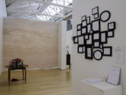 An photograph of the exhibition do it when it was installed at the Gund Gallery in 2013. It features a large work by Sol Lewitt in the background.